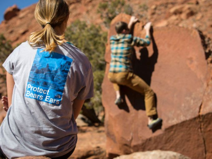 Girl sitting with North Face Protect Bears Ears T-shirt on in Bears Ears National Monument