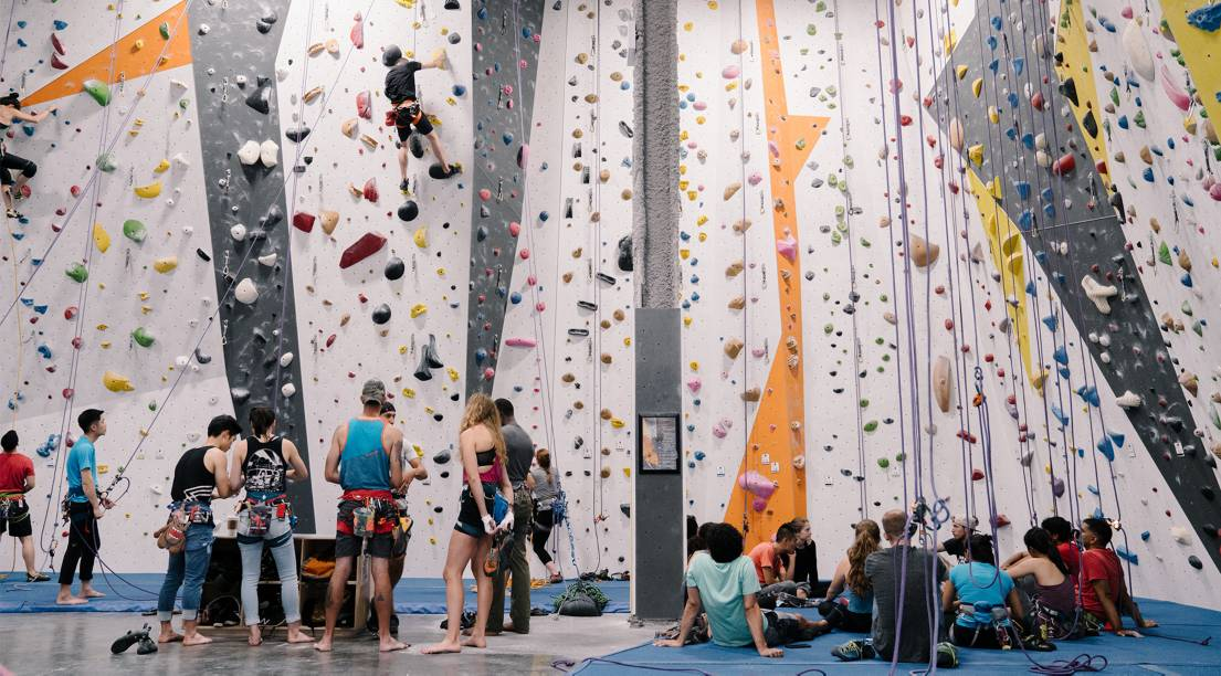 North Face Global Climbing Day climbers top roping at indoor gym