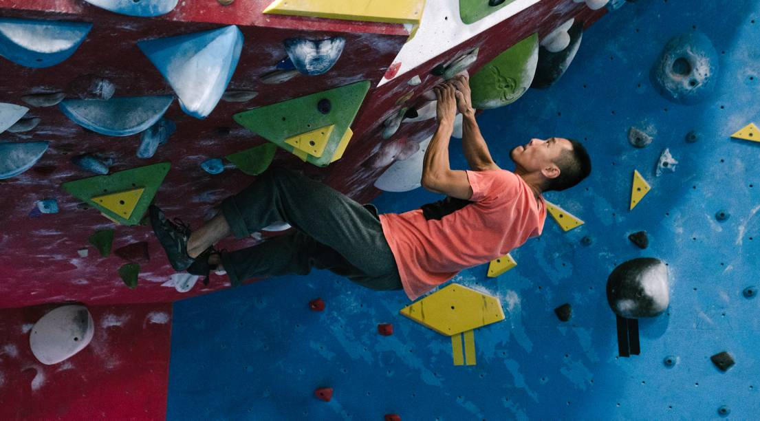 North Face Global Climbing Day guy bouldering upside down on inverted wall