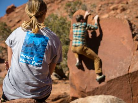 Women sitting in Bears Ears National Monument with North Face Protect Bears Ears T-shirt